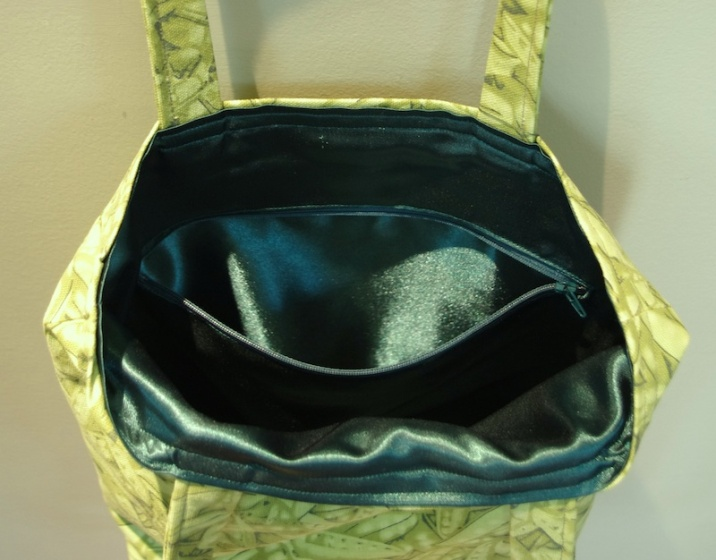 Green Peapod satin lining and deep zippered pocket